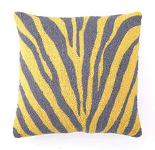 The Zebra Hook pillow from Peking Handicraft, seen here in yellow and gray, is made of a wool and cotton fabric combination. pkhc.com