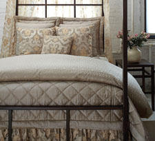 Sheer Damask from Ann Gish consists of pearl silk in the duvet and mica dupione quilting in the Euro shams and coverlet. anngish.com