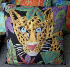 The Leopard pillow from Glory Fibers features hand-painted features on silk, with a designer edge. gloryfibers.com