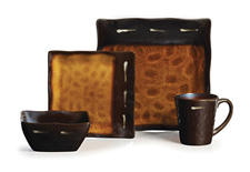 Gallatin, part of the Gourmet Basics by Mikasa collection, offers a unique shape and style with a reactive golden amber glaze over stoneware. mikasa.com