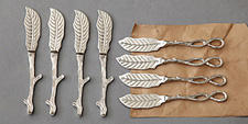 Sets of spreaders with a leaf motif are new from Two's Company. twoscompany.com