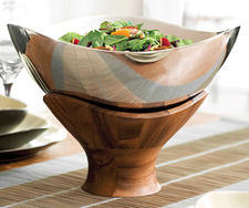 Nambe expands its wood and metal serveware with the Cradle Collection of bowls in several sizes. nambe.com