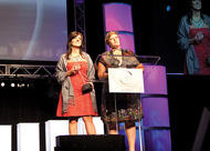 Anthropologie was presented with the ICON 2010 AmericasMart Medal of Excellence Honor during the event. Here, Anthropologie's Cory Weiss-Ewoldsen, left, and Katie Schaeffer accept the award.