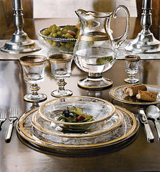 Arte Italica's Vittoria dinnerware and glassware is available in 24-karat gold (shown) and sterling silver. arteitalica.com