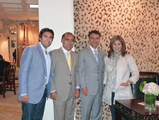 Safavieh's Jonathan Yaraghi, Cyrus Yaraghi and Arash Yaraghi with Suzanne Kasler during her book signing in the Safavieh showroom during market.