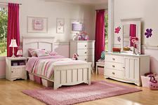 Big girls and little women will feel right at home in this new bedroom set in a cream finish with brass hardware and dimensional effects. southshorefurniture.com