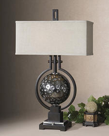 Exclusively designed by Carolyn Kinder, Uttermost's Odin features oil-rubbed, bronze metal surrounding a hammered, antiqued chrome metal ball. uttermost.com