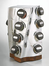 Designed by Neil Cohen, the Nambé spice rack gives a new twist to a classic of gourmet kitchen design with a combination of alternative metal and acacia wood. It comes with 16 engraved bottles filled with the basic spices and retails for $200. nambe.com