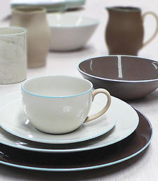 Inspired by the beauty of natural minerals, Wedgwood's Nature's Canvas is a collection that incorporates ceramic and wood in four subtle textures and colors, including Limestone, Sandstone, Clay and Marble. wedgwood.com
