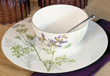 Herbs like cilantro and sage, identified by their Latin names in a handwritten scrawl, take center stage in Villeroy & Boch's new Althea Nova dinnerware. villeroy-boch.com