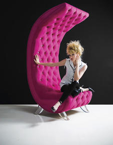 H. Studio's new Moon Chair is a wildly shaped and colored design, here shown in Ultrasuede's Ambiance fabric in Wine and Roses. Girl in the moon optional. haziza.com