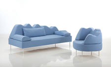 Bruehl introduced a full line of seating, including this powder blue, undulating sofa and chair set, resting on thin metal legs. bruehl.com