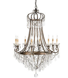 From its Lillian August collection, Currey & Co.?s Scarlett chandelier has a Cupertino finish and is made of wrought iron and crystals. curreycodealers.com