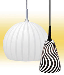 Nora Lighting?s multi-layered art glass pendants grow with the gourd-shaped Bolla and the flaired Ferus designs for a black and white look. noralighting.com