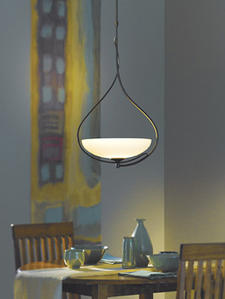 From Hubbardton Forge, the Lira pendant has a hand-forged metal sweep that cradles a glass bowl for a simple and modern look, in two sizes. vtforge.com