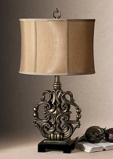 An exclusive design from Billy Moon, Uttermost?s Levada lamp is in a heavily antiqued silver champagne finish with a matte black foot. uttermost.com