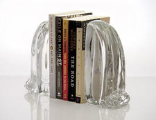 Modern glass artist William Couig of Further Design brings waterfalls into the reading environment, where not one book will get wet. They are sold by Paul Kohn Design. furtherdesign.com