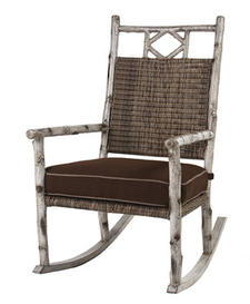 Porch Rocker, call company for price. Resin over aluminium frame creates birch branch look. 800-966-5372, woolrich.com