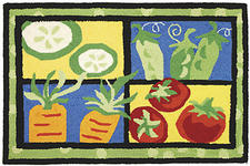 Vegetable Medley rug by Jennifer Stetson, $39.99 for a 22-by-34-inch. A fun, machine-washable way to get your vegetables. madisonatmain.com