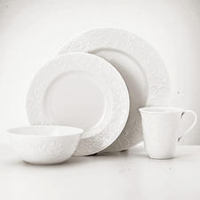 Opal Innocence Carved, four-piece place setting. A flowing vine motif in raised relief decorates the rim.