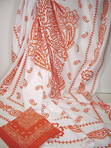 Bandolino. A striking paisley design is presented in orange and white.