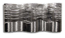 Artisan House?s Sterling River metal wall decor is so real, you?ll think you hear rushing water. $379, 877-658-4630