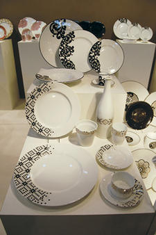 Limoge porcelain dinnerware patterns using asymmetrical placement with lace motifs and platinum mosaics take this manufacturing tradition to a new level.