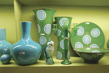 Turquoise shades and emerald greens are used for Asian-inspired porcelain, glass and enamel cloisonn? home decor.