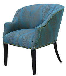 The newest offerings from Norwalk in its ongoing Candice Olson collection include this stylish occasional chair covered in a handsome blue fabric.