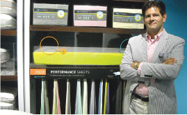 Bedgear CEO Eugene Alletto stands in front of a number of the company's new temperature regulating performance sheets.