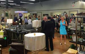 Captivating Guests Mingle During The Opening Of The Nearly 11,000 Square Foot Studio J.
