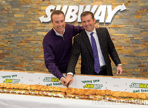 Jason Harris, Left, And Jeff Harris, Furnitureland South, Jamestown, N.C.,  Cut The Ceremonial Sandwich During The Grand Opening Of The Retaileru0027s  Subway ...