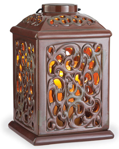 The Ceramic Lanterns come in six reactive glazes, each with its own distinct embossed pattern. A soft halogen light warms the candle from the top, creating the appearance of a lit candle while filling your home with a pleasant fragrance.