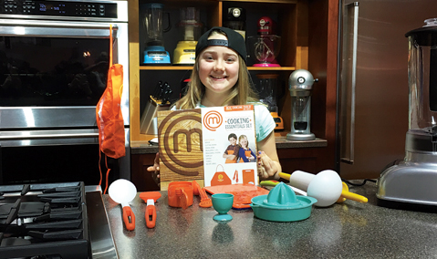 Addison Osta Smith posing at International Home + Housewares Show with Wicked Cool toys