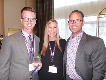 Mark, left, and Tara Kinsley, Leggett & Platt, and Mark Quinn, Sibose LLC before the auction.