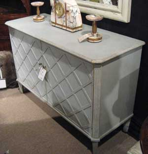 This Swedish-influenced server by Halo Styles has a lattice front and is made with reclaimed pine in a robins egg blue finish. The server retails at around $2,000.