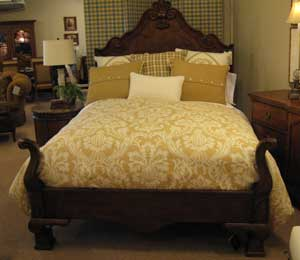 The Town & Country bed by Century Furniture has French design influences. Retailing at $4,995, it is made with curly maple solids and is shown here in an Amaretto finish, one of more than 60 available on the group.