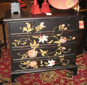 Sterling Inds. showed a number of new chests and other accent furniture. The In Bloom chest features a hand-painted floral design set against a black background