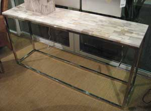 Palecek showed a number of pieces made with petrified wood, including this hall table, which retails at $1,999.