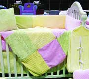Newco International debuted six bedding collections like this set with a mix of textures in shades on pink, yellow and green.