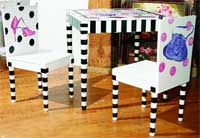 For the littlest fashion diva, this table and chair set from LC Creations includes shoe and purse motifs.