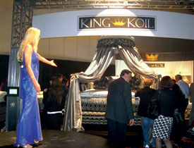 A product presenter showcases the new King Koil line.