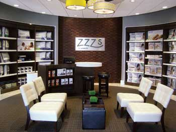 This is the entrance area at the prototype of the ZZZ's by Ashley sleep store in Arcadia, Wis. Consumers can take off their shoes and get slippers to wear in the store, and can drop off their purses and other goods in secure lockers.