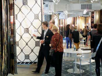 Customers in the Surya showroom in Atlanta look over some of the company's newest flat woven rugs.
