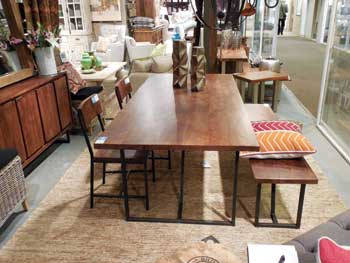 Classic Home's new Kieran dining table is made with solid acacia and has an iron base. The table retails at $1,899 and the companion bench retails at $949.
