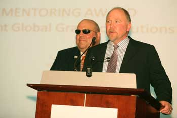 The Mentoring Award is accepted by Greg Wright, left, and Don Wright, both of Wright Global Graphic Solutions. The award recognizes efforts to foster advocacy, development and promotion of women in the furnishings industry.