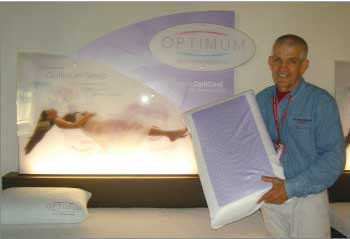 Gallery Furniture owner Jim McIngvale shows a display of Sealy Optimum gel beds in the Houston store.