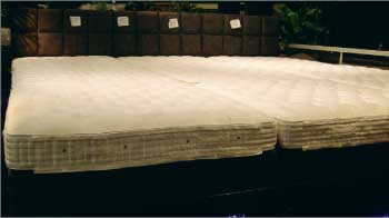 Vi-Spring mattresses at the entrance to Gallery Furniture are pushed together to create a super-sized mattress.