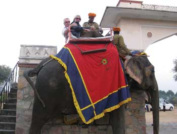 Gary and Jutta Hughes go for an elephant ride in India.