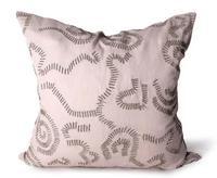 Abstract stitchwork is handembroidered on Bliss Studio's antiquehued linen pillow ($325).